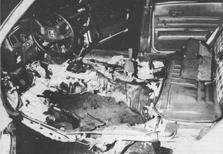 Police photo of Judi Bari's bombed car proves the bomb was hidden under her driver's seat, not in plain view on the back seat floor as FBI claimed.